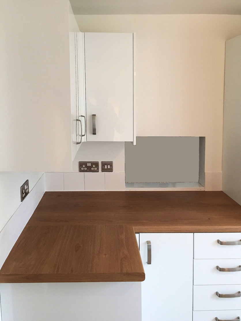 Kitchen refurbishment, worktops installed with mason mitred joints