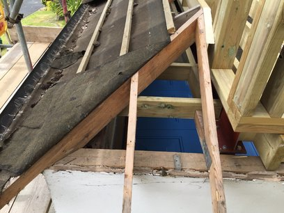Modification of small hip roof to keep the front of the building in keeping.