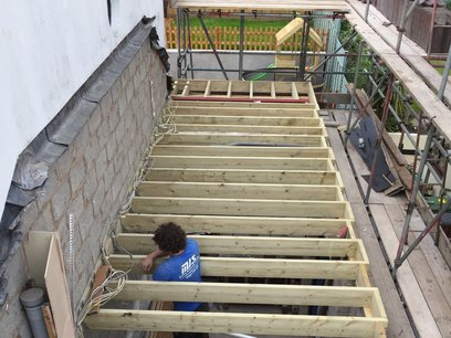 Installation of new floor joists ready to deck out to build timber frame