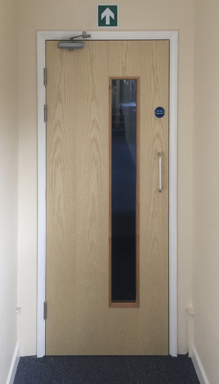 Fire door inspection revealed Fire doors in a factory corridor were not compliant. by MJS