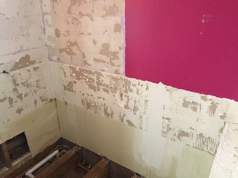 Old wall coverings and tiles removed back to original surface.