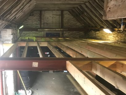 Mezzanine floor, joists trimmed out for the staircase.