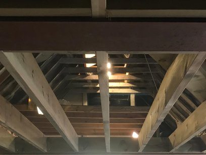 Mezzanine floor, Timber joists notched into steels for support.