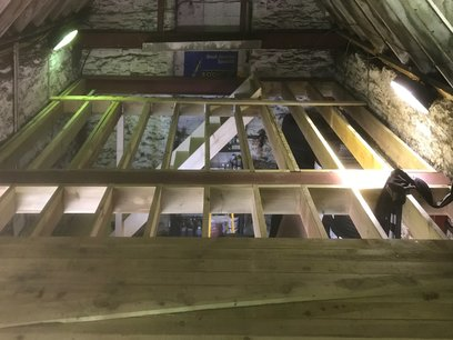 Mezzanine floor, 4x1 timber laid over joists and fixed.