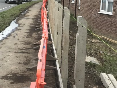 Fence posts set and lined through with lines.