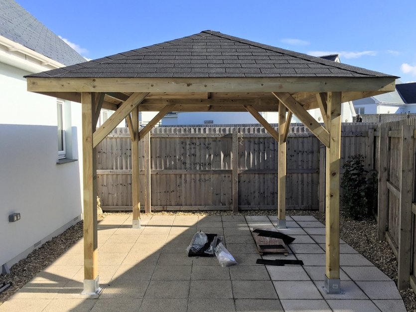 Gazebo complete and bolted to the ground using galvanized post shoe.