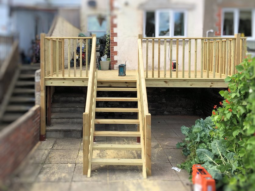 Decking completed, now with useable ground floor patio and staircase leading to garden