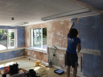 Refurbishment of classroom during summer holidays, walls stripped down to existing plaster.