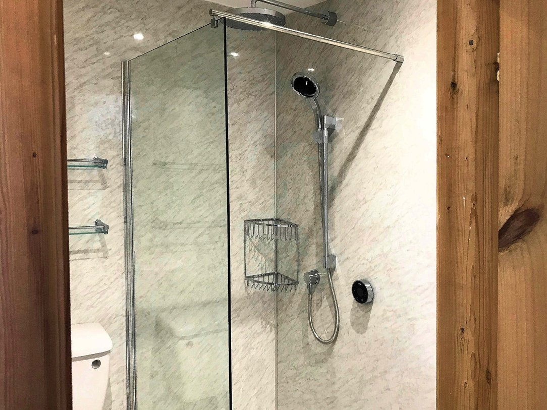 New WC, a digital controlled shower drench shower, vertical towel rail with matching wall fixtures shelves and baskets. Barnstaple North Devon
