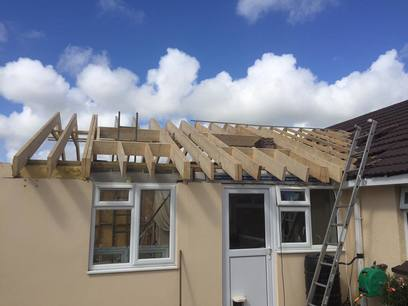 Truss roof with Velux windows by MJS Building Maintenance Ltd.
