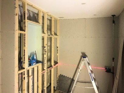 Construct new studwork to house recessed cupboard and conceal all pipework. Wet Room North Devon