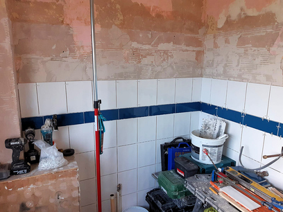 Full height white tiling with a row of vision enhancing contrasting blue tiles at waist height, Barnstaple North Devon