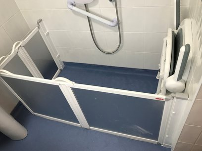 Level access shower area with a fold down seat and carer screens when required, Barnstaple North Devon