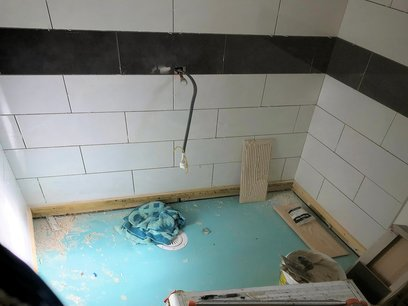 Level access shower room floor installation with central drainage point, Barnstaple North Devon