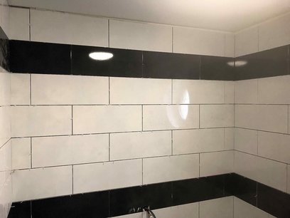 Blue tiles to enhance impaired vision in level access shower, Barnstaple North Devon