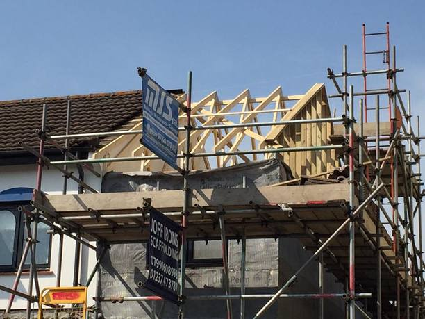 Installation of new timber roof trusses with internal wind bracing. Roof was covered with membrane and baton, ready to receive original tiles