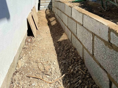 Pathway Transformation: Sloped retaining wall. North Devon