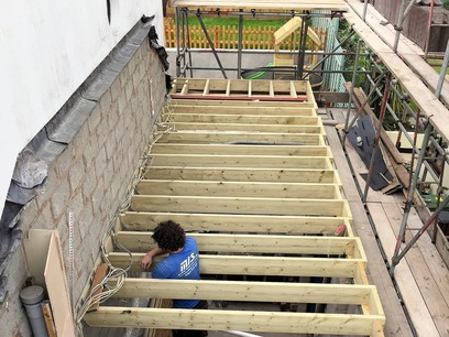 Installation of new floor joists ready to deck out to build timber frame, part of house extension in Barnstaple North Devon