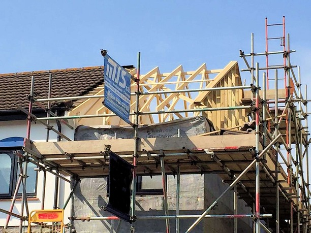 Installation of new timber roof trusses with internal wind bracing. Roof was covered with membrane and baton, ready to receive original tiles, part of house extension in Barnstaple North Devon