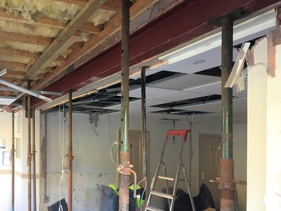 Installation of new steel to take down dividing wall for open plan area. Reception refurbishment in North Devon