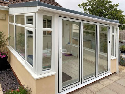 Installation of bi-fold full height glass doors. Conservatory. Barnstaple North Devon