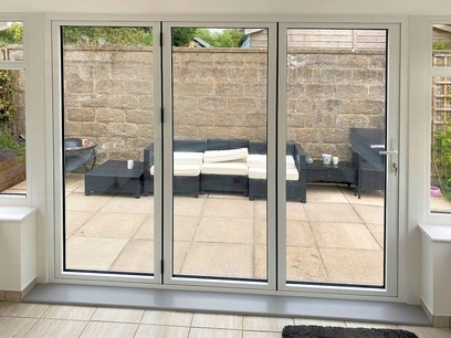New outlook to patio through completed bifold doors. Conservatory. Barnstaple North Devon